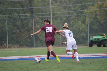 Junior Ashley Weaver races for possession of the ball
