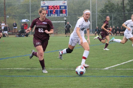 Junior Stephanie Allshouse pushing Bloom towards to sideline and away from the goal.